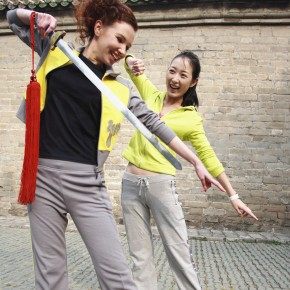 Two Young Women Practicing With Ceremonial Sword